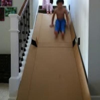 This indoor activity is sure to score you coolest mom of the year award! You'll need a large appliance box and a stairway, if you have those two things, its as easy as that! Next with parental supervision of course, take turns sliding!