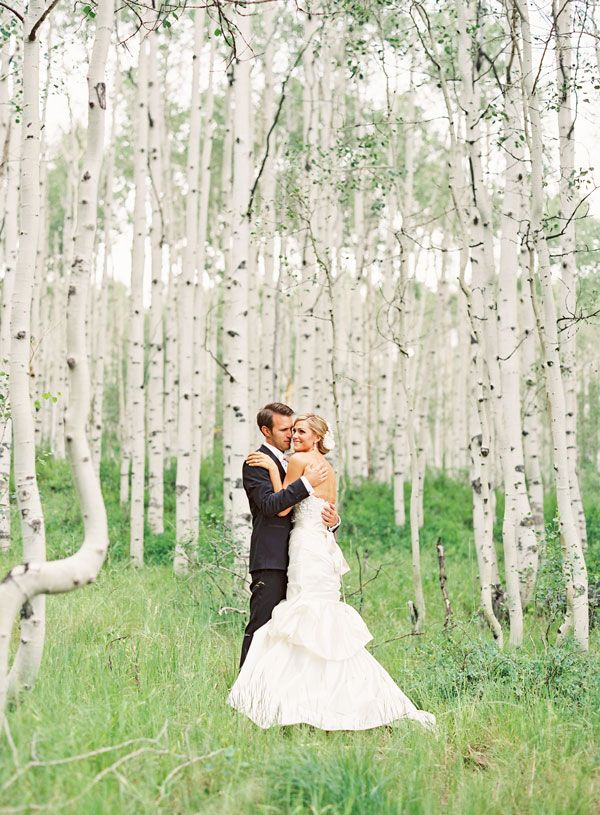 What a gorgeous backdrop for a wedding picture! We love how the almost white bark of the trees softens the background to match the bride's wedding dress.
