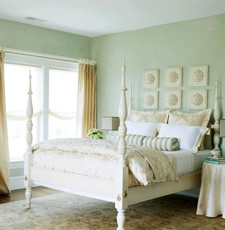 sea green bedroom walls white four poster bed & coastal vintage nautical touches with stripes