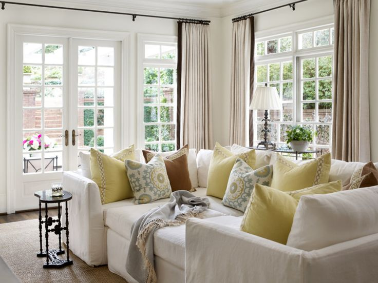 "The designer chose a Mitchell Gold sectional for the family room and filled it with pretty pillows. ""The homeowner wanted a piece she and her son and husband could really use and cuddle up in,"" says Jessica. ""It can be changed around because it's so versatile. Her son has even had sleepovers on it."""