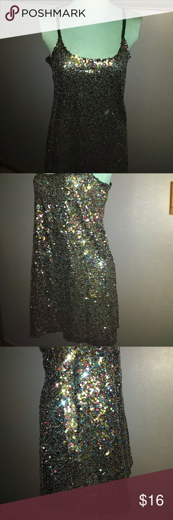 "Free People Sequin Tunic Polyester tunic with multiple colors sequin design style black adjusting straps scoop neckline in front and back all sequins in place easy to dress up or down is 29"" long and 19 1/2"" across from armpit to armpit Free People Tops"