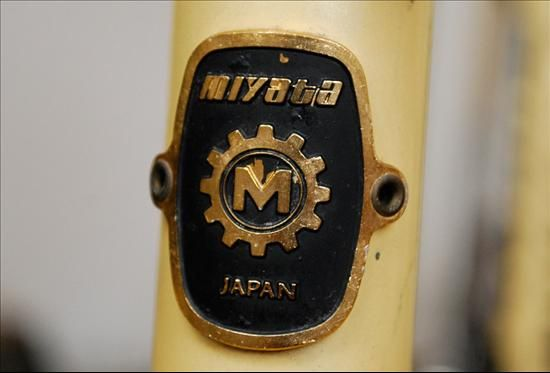 Miyata Headbadge Brand: Miyata Country: Japan Years: 1970's Found On: Vintage Lightweights Additional Info: Miyata Japan attached head badge. This exact style badge also found its way onto some of the Koga Miyata frames sold in The Netherlands. VeloBase.com - Head Badge Gallery