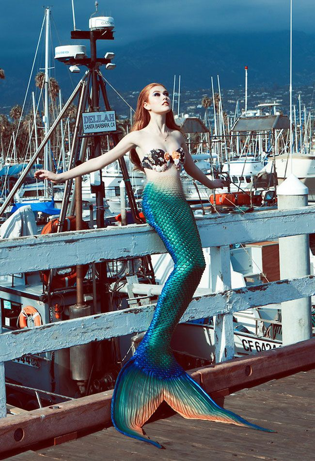Kat McNamara as a mermaid for a photo shoot with Project Mermaid. She is sitting