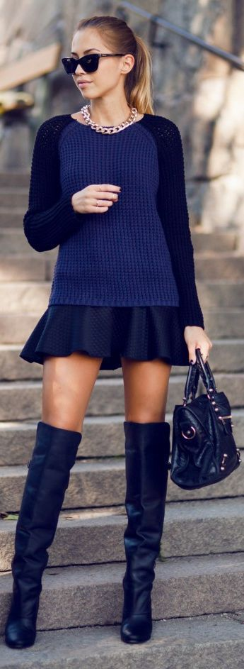 This combo of a navy crew-neck jumper and a black quilted pleated skirt gives off a very casual and approachable vibe. Take a classic approach with the footwear and throw in a pair of black leather over the knee boots.  Shop this look for $90:  http://lookastic.com/women/looks/sunglasses-necklace-crew-neck-sweater-skater-skirt-satchel-bag-over-the-knee-boots/7049  — Black Sunglasses  — Gold Necklace  — Navy Crew-neck Sweater  — Black Quilted Skater Skirt  — Black Leather Satchel Bag  — Black…