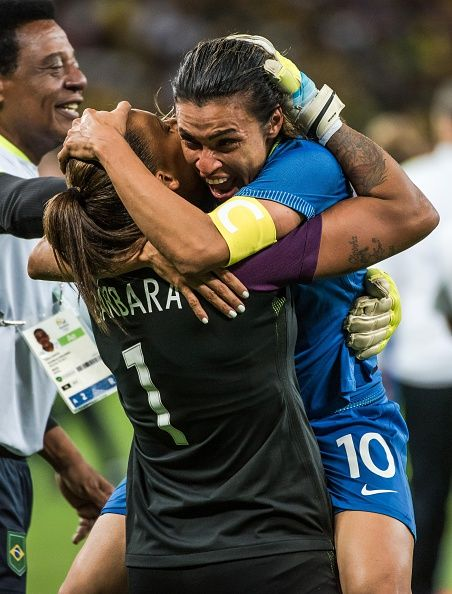 #RIO2016 Brazil's Marta celebrates with goalkeeper Barbara after defeating Australia in the penalty shootout of their Rio 2016 Olympic Games women's...