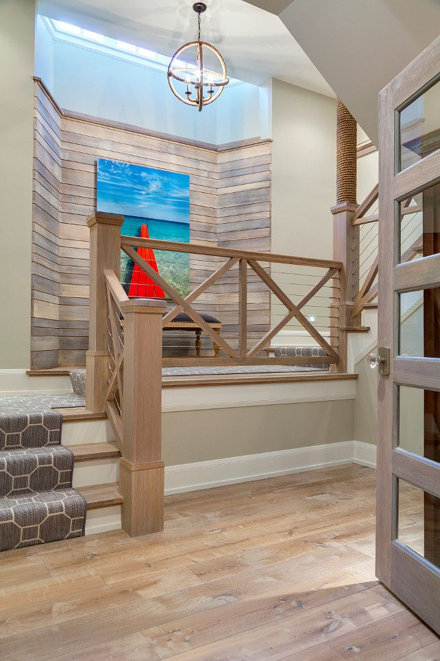 Staircase Railing. Coastal Inspired Staircase Railing. Driftwood wall, plank hardwood floors, plank hardwood staircase with wood and rope railing. #Staircase #Railing #CoastalHome Great Neighborhood Homes.