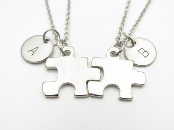 Puzzle piece necklaces with personalized stamped monogram initials. $26