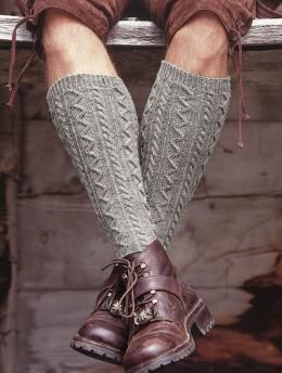 Free Men's Knee-Length Socks pattern - Two types of cables combine with twisted knit and purl stitches in the background to make this pair of knee-high socks look like a pullover from the Aran islands.