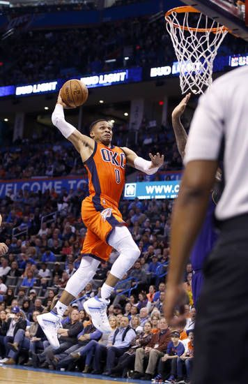 Oklahoma City's Russell Westbrook (0) goes up for a dunk over New Orleans' DeMarcus Cousins (0) during the NBA basketball game between the Oklahoma City Thunder and the New Orleans Pelicans at the Chesapeake Energy Arena, Saturday, Feb. 25, 2017. Photo by Sarah Phipps, The Oklahoman
