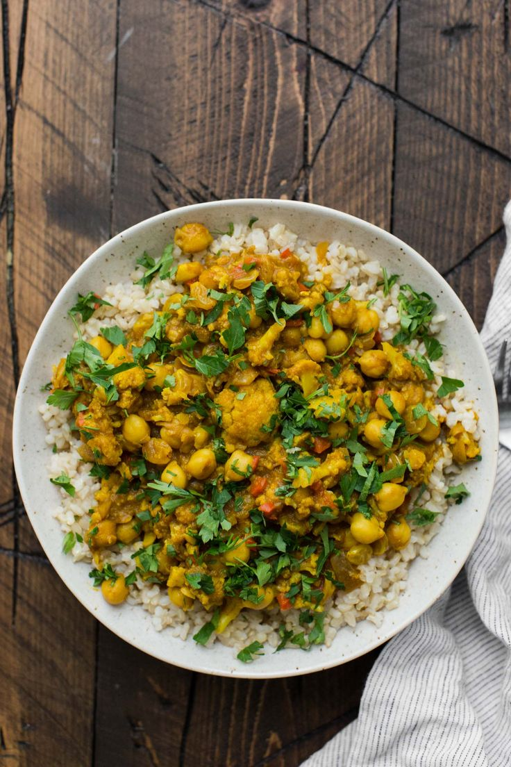 A rich and flavorful African curry, Cape Malay Curry, is packed with cauliflower and chickpeas. This vegan curry is rich and creamy without coconut milk.