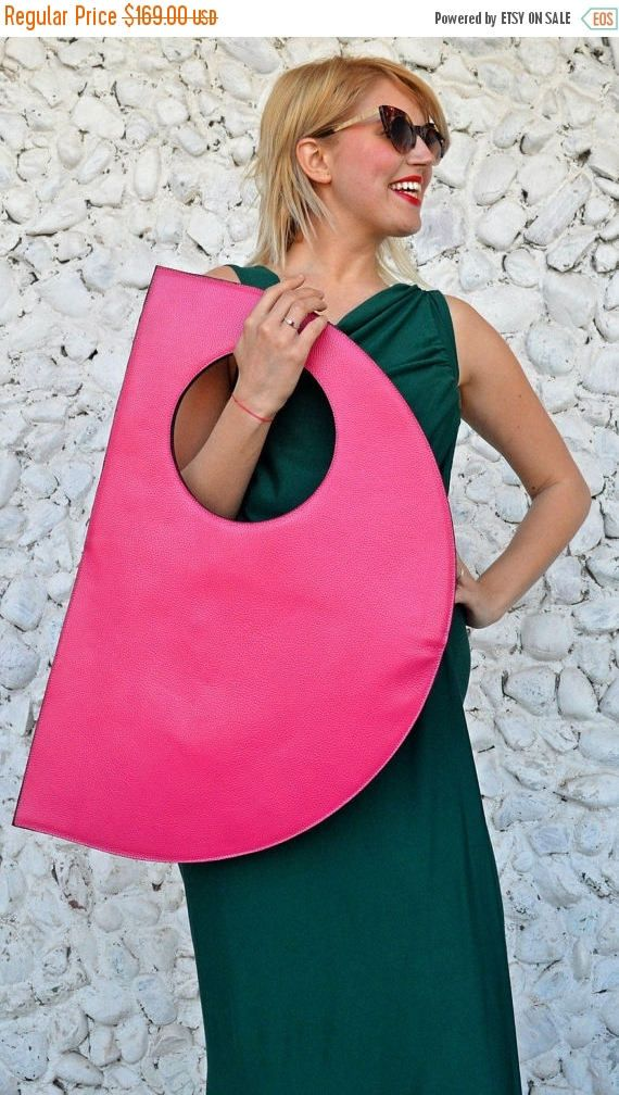Genuine leather bag, extravagant and so easy to wear. Large bag, versatile and fun, that can carry the necessary everyday things. Extravagant bag that will jazz up your wardrobe and conquer the urban scene!  Material: 100% genuine leather  Size: Length - 31.5 (80 cm) / Width: 19.6 (50 cm)