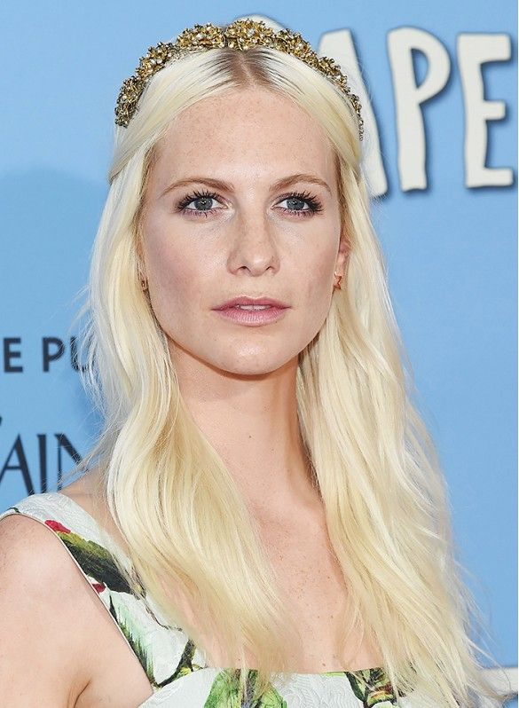 Poppy Delevingne rocks dewy skin, shimmery eyes and rosy cheeks for a soft look.