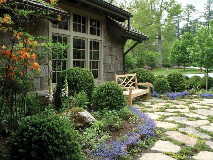 This Outdoor Space Features A Flagstone Paver Patio With Groundcover Plants  Growing Between The Stones,