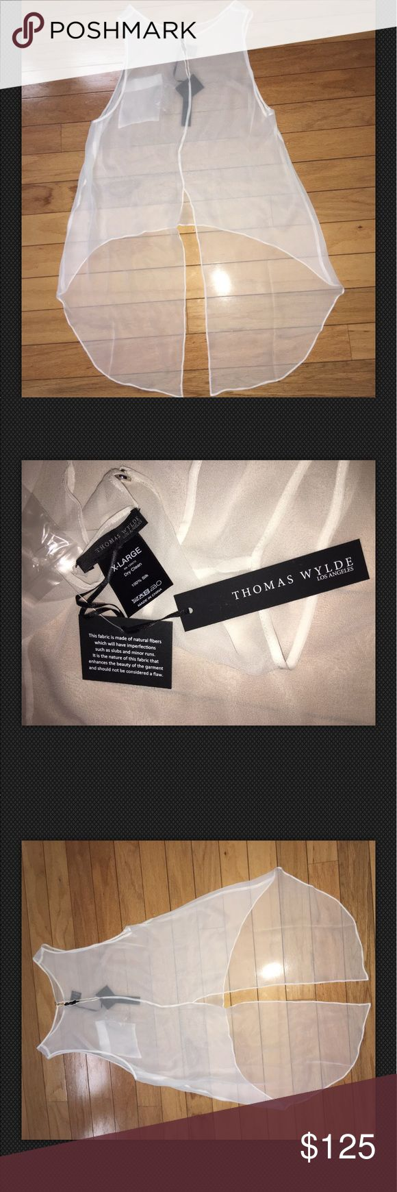 100% Authentic Thomas Wylde XL MSRP $165 100% Authentic Thomas Wylde XL MSRP $165 Material 100% Silk  Please note 100% Authentic wrinkles due too prepackaged 100% Authentic.       #300035/XL Thomas Wylde Tops Blouses
