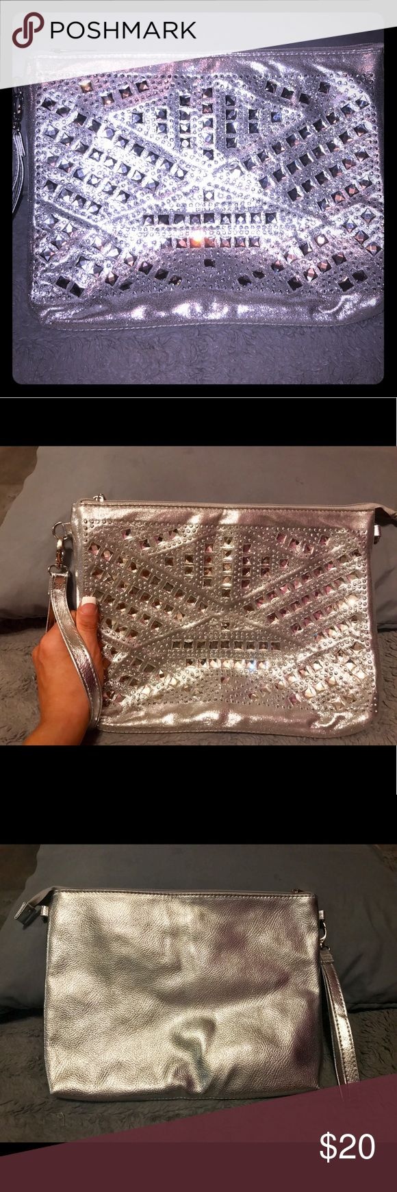 Bling &silver large clutch bag Brand new! Gorgeous bling clutch with rhinestones. So shiny and pretty . Goes with everything and fits makeup, phone, even. Full size wallet and more Bags Clutches & Wristlets