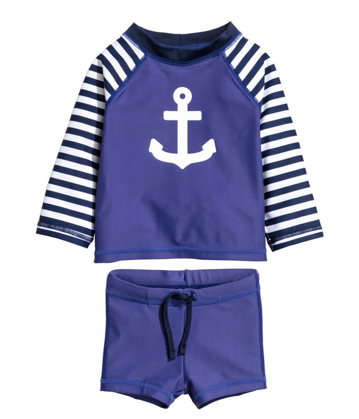Check this out! Swim shorts and top in UV-protective fabric. Top with long raglan sleeves and small collar. Shorts with elasticized drawstring waistband and lined front. UPF 50. - Visit hm.com to see more.
