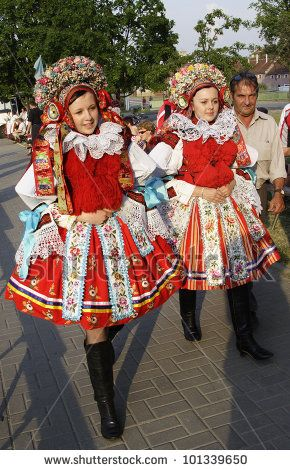 Czech traditional costumes are different in some regions. The main colors usually red, white and black. while the ridiculously big fluffy puff sleeve and skirts are fermine, the black leather boots are quite manly. The differences between this image and the Miss Czech image is that they wear a beautiful and colorful headband with so many details and the poms poms in front of their chest. It traditional and fashionable at the same time xD~