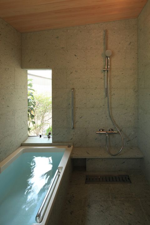 Combined bathshower area open concept all tile no glass