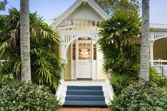 Aussie Yellow House <3 the gingerbread trim & blue painted stairs