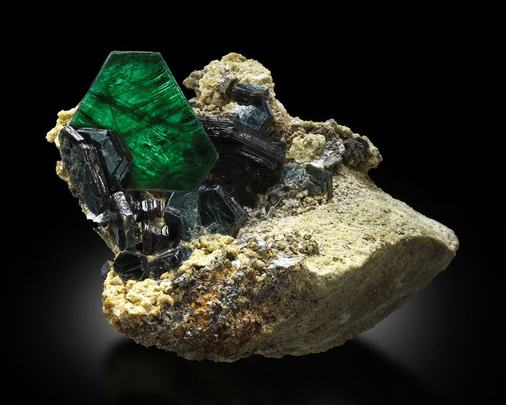 Clintonite  Locality: Crestmore Quarries, Crestmore, Riverside County, California, USA  Dimensions: 10.0*10.5*4.0 cm / Main crystal size: 3.2 cm  Description: Matrix covered with standing sharp and flat hexagonal prisms. These crystals are slightly translucent with a beautiful emerald green color. MIM number 1602 Photographer: FMI/James Elliott