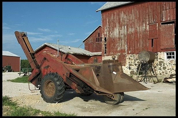 Farmall F-20 mounted Picker. Uncle Gerald had one of these. Hand crank to start it. Was touchy or he said you could get your arm broken.