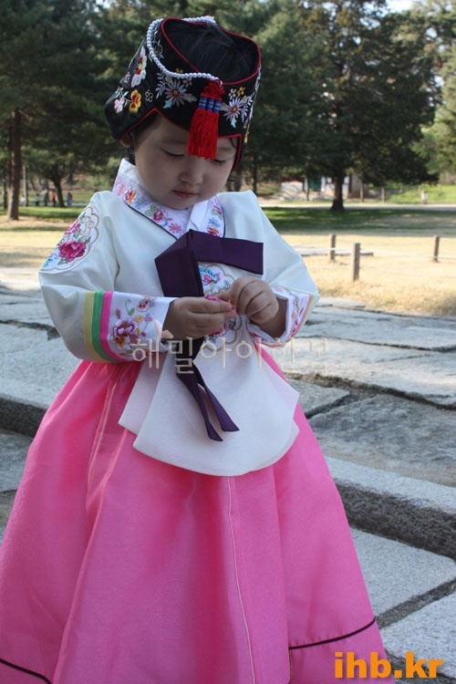 Girl wearing Hanbok & head gear, Korea