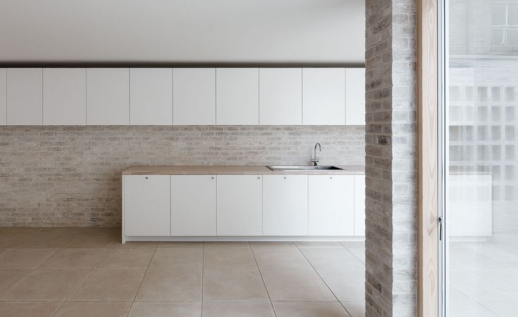 A neutral and light coloured material pallette enhances the interior's sense of calm, while also encouraging sunlight to reach deep inside the house