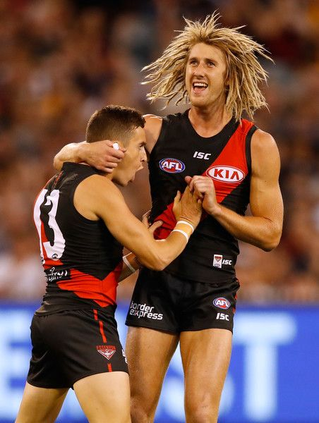 Orazio Fantasia of the Bombers celebrates the first goal with Dyson Heppell of the Bombers during the 2017 AFL round 01 match between the Essendon Bombers and the Hawthorn Hawks at the Melbourne Cricket Ground on March 25, 2017 in Melbourne, Australia.