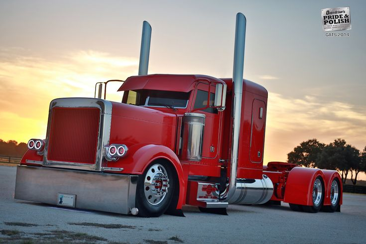 "Mike Lemley's 2000 Peterbilt 379, ""Cathouse,"" won Best of Show at the Great American Trucking Show in 2014. Lemley's rig has a mix of painted parts – the fenders, drop visor and grille – while still sporting a little chrome on the stacks and front bumper. The clean lines of Lemley's rig play well on the Pride & Polish circuit today."