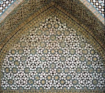 Archway from the Darb-i Imam shrine, Isfahan, Iran (1453 C.E.) with two overlapping girih patterns. Image courtesy of K. Dudley and M. Elliff