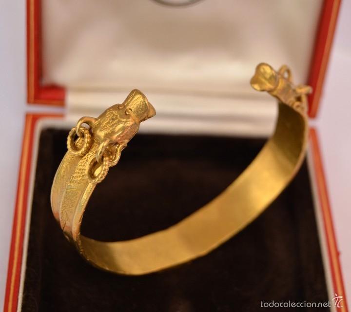 Brazalete oro solido cabeza de Dragón A.C Subastado en Sothebys An East Gold Bracelet Dragon head - Foto 1