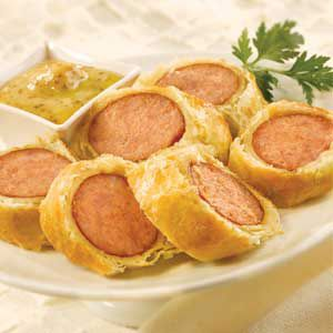 Perfect for your next party, these tasty appetizers have it all wrapped up...rolls of puff pastry filled with spicy kielbasa and honey mustard...delicious!