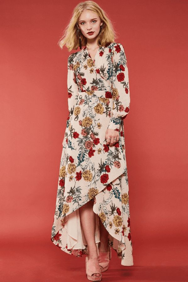"Floral Maxi Dress - 12% OFF  $66.00 USD Description:A flower pattern maxi dress featuring wrapped design, long sleeves with buttoned cuff, surplice front, waist self-tie and hi-low hem detail. This dress is made with medium weight flower pattern fabric that is very soft and drapes beautifully. Size: S/M/L Color: Multi Material: 100% Polyester Season: Fall/ Winter Hand wash cold Imported Model's height is 5'8"", wearing size S USE CODE: NEW12 to receive 12% OFF, Ends: 12/8 @11:59pm"