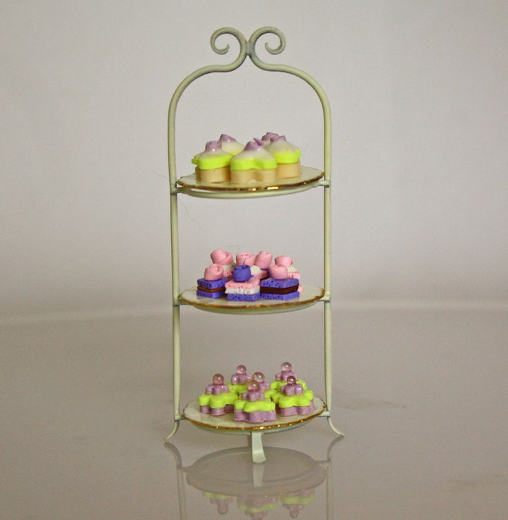 3 tiered white dessert stand with 3 plates.  By  J. Getzan