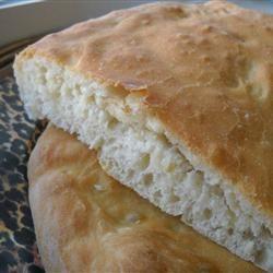 """Lepinja (Serbian Flatbread) - """"I had a Croatian coworker who would bake this anytime we had a celebration at work. I finally got her to share her recipe with me. I've had to tweak it quite a bit because some ingredients she doesn't measure and of those she does, she uses metrics.""""    Allrecipes.com"""