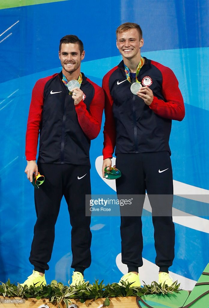 Silver medalists David Boudia and Steele Johnson of the United States celebrate on the podium during the medal ceremony for the Men's Diving Synchronised 10m Platform Final on Day 3 of the Rio 2016 Olympic Games at Maria Lenk Aquatics Centre on August 8, 2016 in Rio de Janeiro, Brazil.