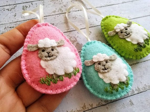 Felt easter decoration - felt eggs with sheep, lamb Listing is for 1 ornament Different colors available. Handmade from wool blend felt Size of my decorated eggs is about 2 1/8 x 2 5/8 inch (5,3 x 6,5 cm) This is size of felt egg without hanging loop
