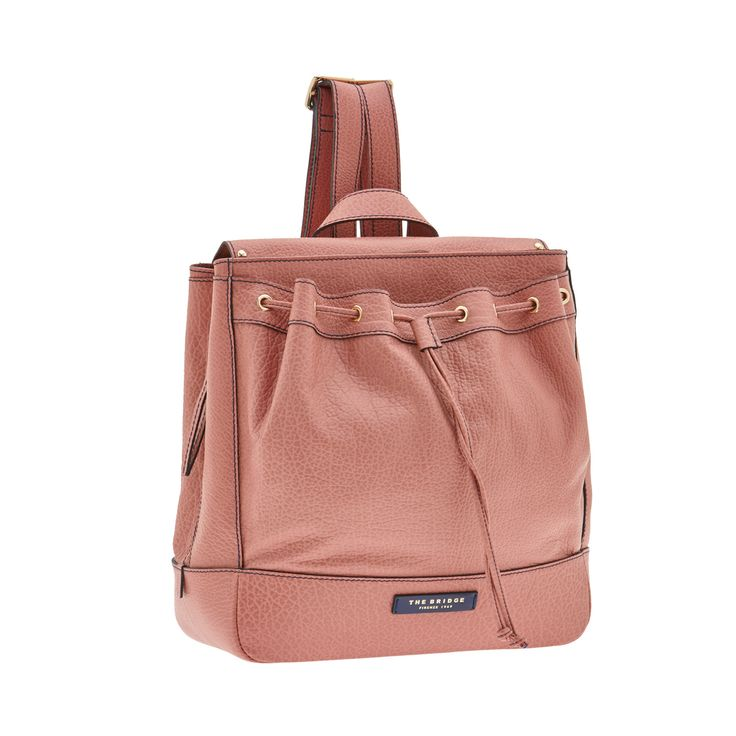 This leather backpack from The Bridge features an elegant, practical design. With plenty of space for all your daily essentials. With drawstring closure, it is the perfect accessory for a casual chic outfit.  Size 34X35X12 cm. #TheBridgeBags