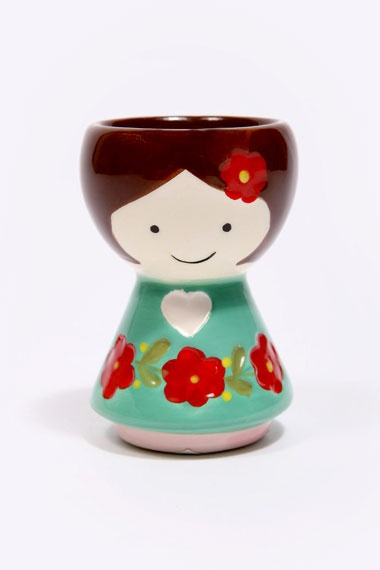 How do you like your eggs in the morning? In this ceramic doll cup of course! Whether you like yours hard boiled or runny, this painted pretty holds your egg safely in her hair.