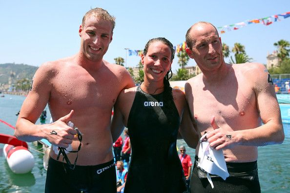 Thomas Peter Lurz, Christian Martin Reichert and Isabelle Franziska Harle of Germany pose after finishing the Open Water Swimming Team 5k race on day six of the 15th FINA World Championships at Moll de la Fusta on July 25, 2013 in Barcelona, Spain.