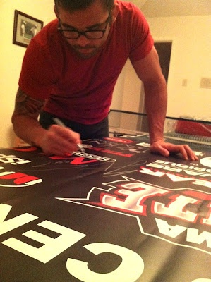 Jamie Varner signing his UFC on Fox 4 fight banner for it's new (and very lucky) owner. #MMA