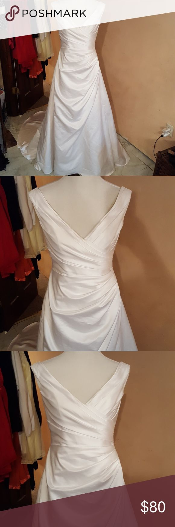 Brand new wedding gown Never worn or even tried on. David's bridal wedding gown. 4th picture shows dress with under skirt to make it look fuller. The skirt is also available to buy David's Bridal Dresses Wedding