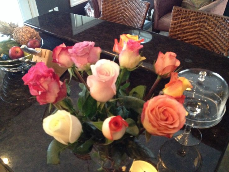 Multi coloured roses brighten up a winters kitchen.