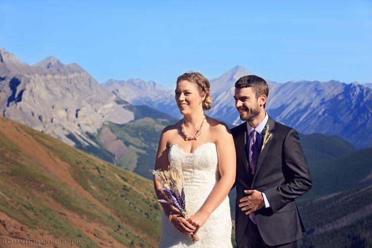 Bride & groom's wedding ceremony on side of mountain in Canmore Alberta. Summer heli-wedding. Canmore Alberta weddings.