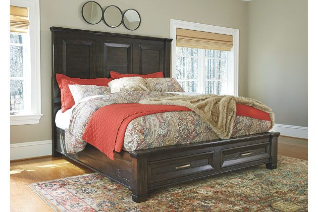 Inspired by the timeless appeal of American classic furnishings—where clean lines, sturdy silhouettes and thoughtful detailing speak volumes—Townser king storage bed revisits tradition in style. It's crafted of 100% pine wood with a roughly milled texture enhanced by a deep finish with gray undertones. Tall headboard with framed recessed panels brings an element of high drama. Two drawers incorporated into the footboard merge form and function. Mattress sold separately.