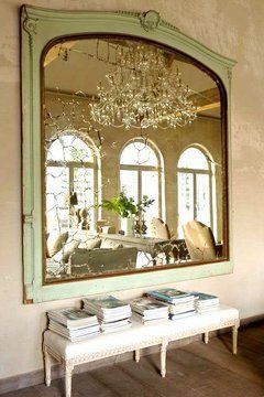 Massive wall mirror doubles the natural lighting from arched french doors and will create a spectacular effect at night when the chandalier is alight. Simply gorgeous! COCOCOZY