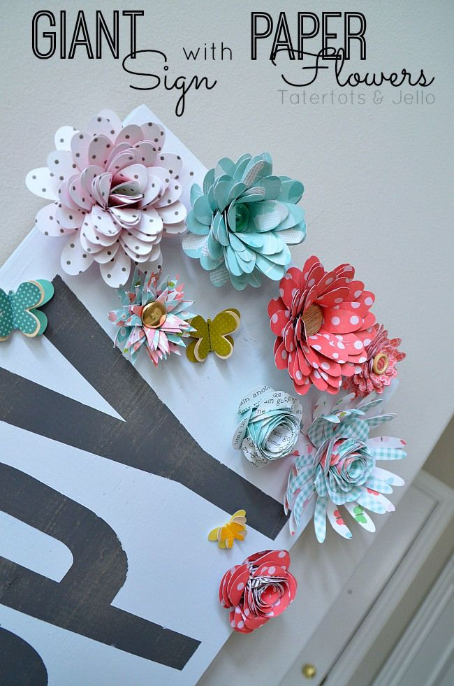 Make a giant sign with paper flowers. Tutorial available at tatertots and jello. Use your Cricut to make the letters and cut the flowers. Wow! #Cricut #PaperFlowers