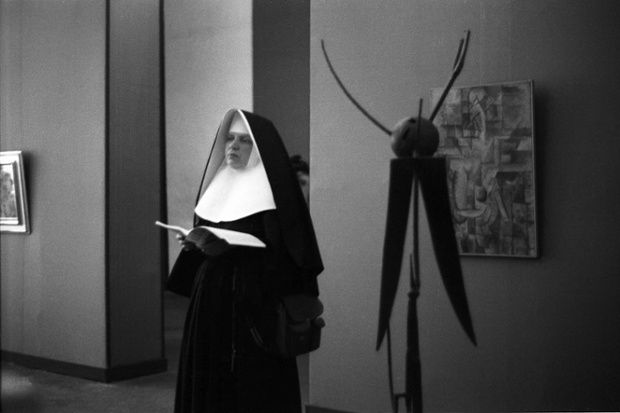 I loved the series of pictures in the Guardian today -- pictures at exhibitions (literally so) by Hans Haacke. This one is called Gonzales Nun [1959]. The sculpture in the background is (I think) by Julio Gonzales.