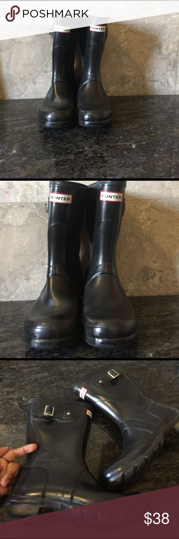 Short Hunter boots Pre loved with defects. Can be cleaned and repaired but I will leave that up to you in exchange of an awesome price. This are high in demand and sell like new condition for $95.00 I add new pairs weekly. So if you don't mind the tear and wear these are all yours.size 7 but run a one size big. Hunter Boots Shoes Winter & Rain Boots