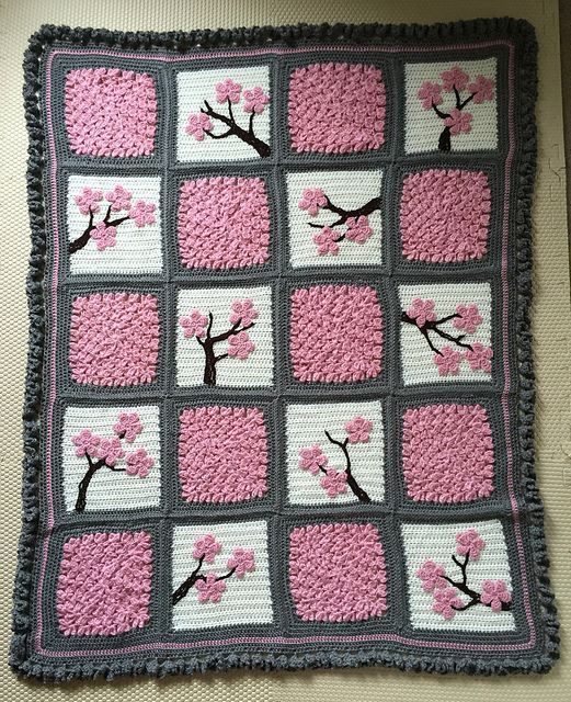 How to Make a Cherry Blossom Crochet Blanket | Mix solid granny squares with floral ones for this unique patchwork effect